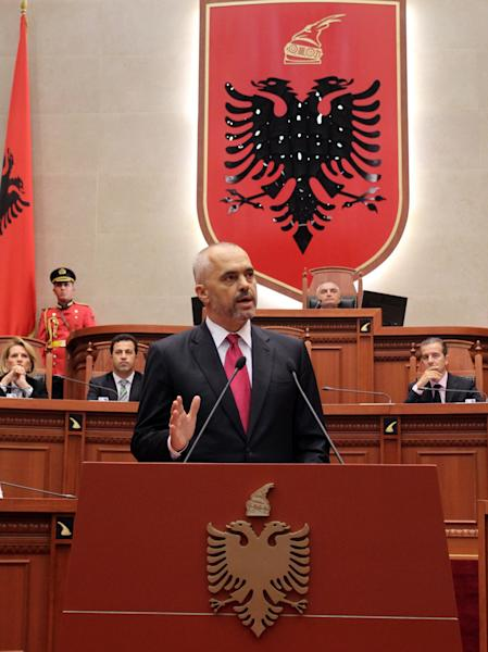 Albania's new Socialist Prime Minister Edi Rama speaks at the Parliament promising to make his country less reliant on remittances from migrant workers by creating 300,000 jobs at home, Wednesday, Sep. 11, 2013. Rama formally presented his policies to parliament, at the start of a debate that at the end would confirm nominations for his 20-member cabinet, which would then be formally sworn in. (AP Photo/Hektor Pustina)