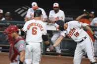 Baltimore Orioles' Ryan Mountcastle (6) is greeted by Baltimore Orioles' Trey Mancini (16) after hitting a solo home run against Los Angeles Angels starting pitcher Dylan Bundy during the first inning of a baseball game Tuesday, Aug. 24, 2021, in Baltimore. (AP Photo/Terrance Williams)