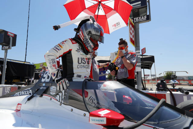 Marco Andretti climbs into the cockpit of his car during practice for the IndyCar auto race at Texas Motor Speedway in Fort Worth, Texas, Saturday, June 6, 2020. (AP Photo/Tony Gutierrez)