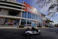 Workers drive past Raymond James Stadium ahead of Super Bowl 55 Thursday, Feb. 4, 2021, in Tampa, Fla. The city is hosting Sunday's Super Bowl football game between the Tampa Bay Buccaneers and the Kansas City Chiefs. (AP Photo/Charlie Riedel)