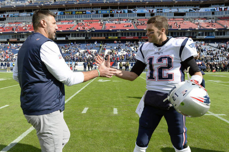 Tennessee Titans head coach Mike Vrabel greets New England Patriots quarterback Tom Brady (12) before an NFL football game Sunday, Nov. 11, 2018, in Nashville, Tenn. (AP Photo/Mark Zaleski)