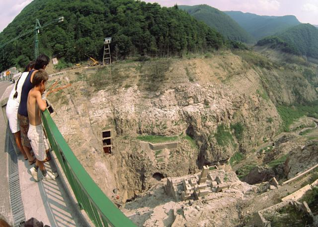 Visitors look down on the ruins of Fabbriche di Careggine after it became visible during dam maintenance work. (Getty)