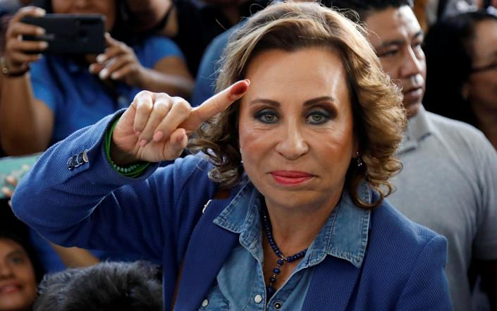Presidential candidate Sandra Torres, of the National Unity of Hope (UNE) political party, shows her ink-stained finger after casting her vote - REUTERS