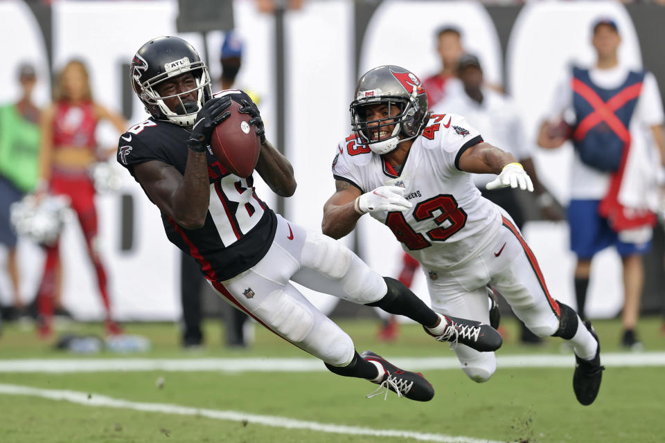Atlanta Falcons wide receiver Calvin Ridley (18) makes a diving touchdown reception in front of Tampa Bay Buccaneers defensive back Ross Cockrell (43) during the second half of an NFL football game Sunday, Sept. 19, 2021, in Tampa, Fla. (AP Photo/Mark LoMoglio)