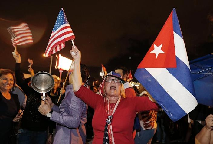 In Miami, home to the largest community of Cuban exiles who fled Fidel Castro's rule, euphoric crowds erupted into loud celebration on news of his death (AFP Photo/Rhona Wise)