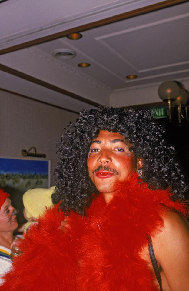 The England cricket team attend a Christmas party during their Australian tour, December 1986. Dominican-born Phil deFreitas sports a red boa and wig. (Photo by Adrian Murrell/Getty Images)