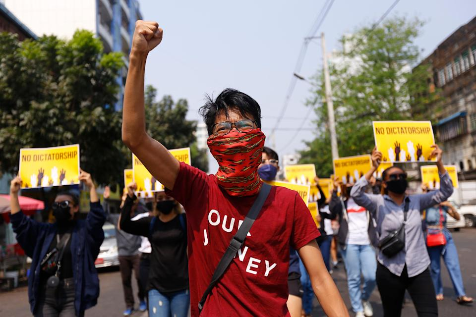 In this 26 March 2021 file photo  anti-coup protesters gesture during a march in Yangon, Myanmar. An American journalist was recently released after spending more than three months inside a notorious Myanmar prison (Copyright 2021 The Associated Press. All rights reserved)