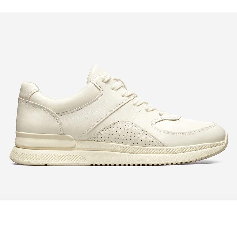 """<p><strong>Everlane</strong></p><p>everlane.com</p><p><strong>$98.00</strong></p><p><a href=""""https://go.redirectingat.com?id=74968X1596630&url=https%3A%2F%2Fwww.everlane.com%2Fproducts%2Fmens-trainer-offwhite&sref=https%3A%2F%2Fwww.esquire.com%2Fstyle%2Fmens-fashion%2Fg32631767%2Fsummer-mens-fashion-memorial-day-sale%2F"""" rel=""""nofollow noopener"""" target=""""_blank"""" data-ylk=""""slk:Buy"""" class=""""link rapid-noclick-resp"""">Buy</a></p><p>The debut sneaker from a brand that you can now actually wear from head to toe. <br></p>"""
