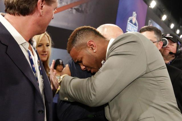 Eric Ebron, from North Carolina, is congratulated after being selected 10th overall by in the first round of the NFL football draft the Detroit Lions, Thursday, May 8, 2014, at Radio City Music Hall in New York. (AP Photo/Jason DeCrow)