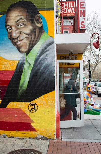 A mural of comedian Bill Cosby painted on the side of Ben's Chili Bowl in Washington, DC (AFP Photo/Jim Watson)