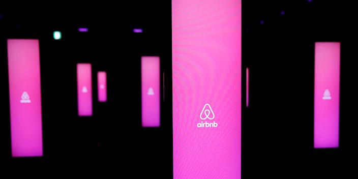 The logos of Airbnb are displayed at an Airbnb event in Tokyo, Japan, June 14, 2018.