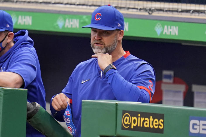 Chicago Cubs manager David Ross stands in the dugout during the team's baseball game against the Pittsburgh Pirates in Pittsburgh, Saturday, April 10, 2021. (AP Photo/Gene J. Puskar)