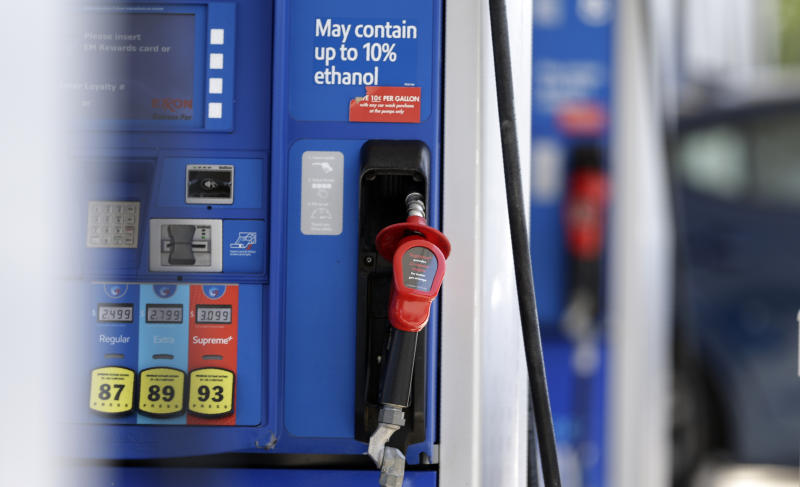 FILE - This June 26, 2019, file photo shows a gasoline pump at a refueling station in Pittsboro, N.C. On Tuesday, Aug. 13, the Labor Department reports on U.S. consumer prices for July. (AP Photo/Gerry Broome, File)