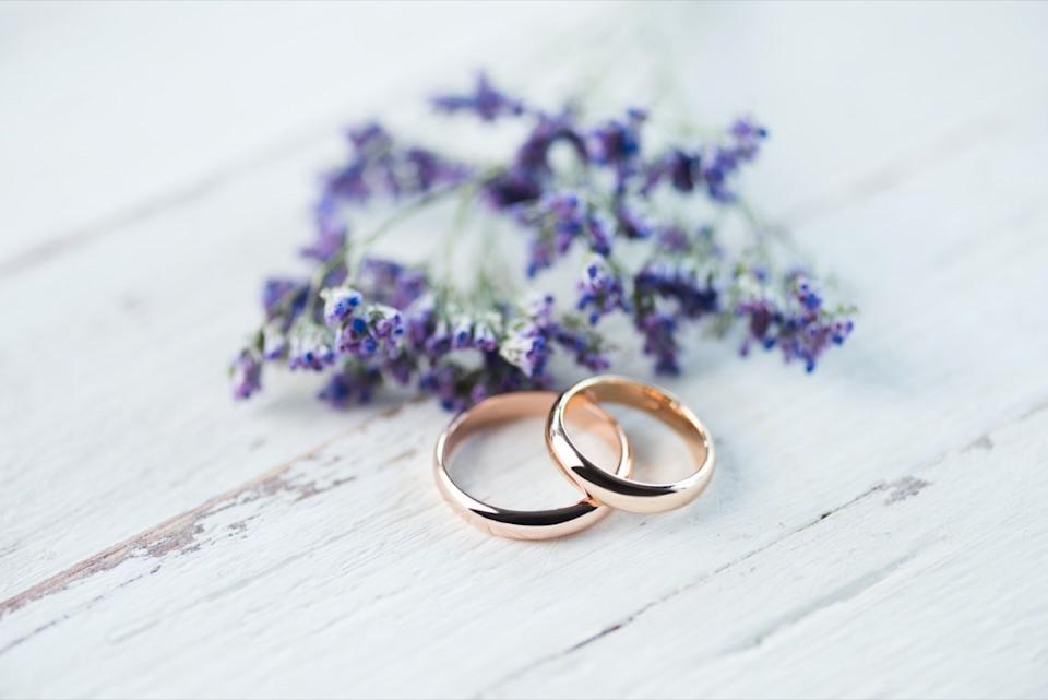 Wedding rings with lavender on table