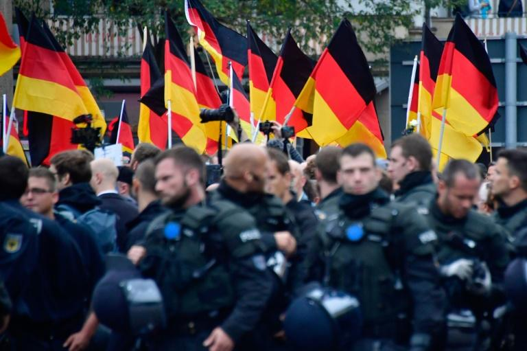 Thousands of demonstrators took to the streets of Chemnitz in western Germany on Saturday in two separate marches, one in support of the government's immigration policy, the other against