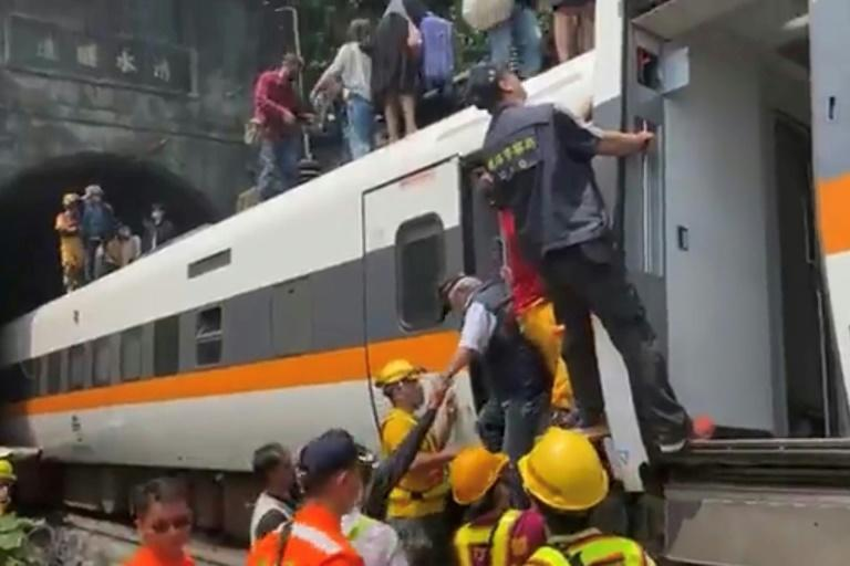 Officials said the accident could have been caused by a maintenance vehicle sliding down an embankment and striking the train before it entered the tunnel near the coastal city of Hualien