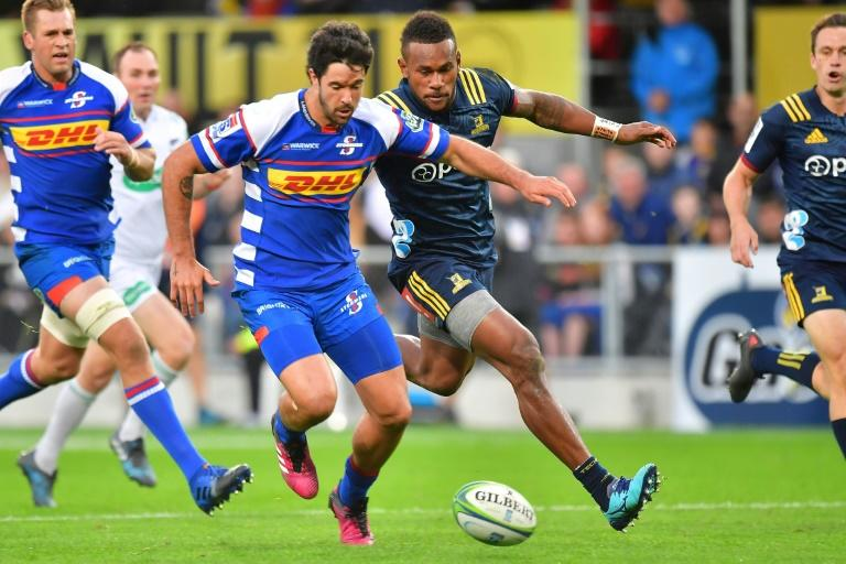 Otago Highlanders' wing Tevita Nabura (R) is suspended from Super Rugby until July 6 following his mid-air