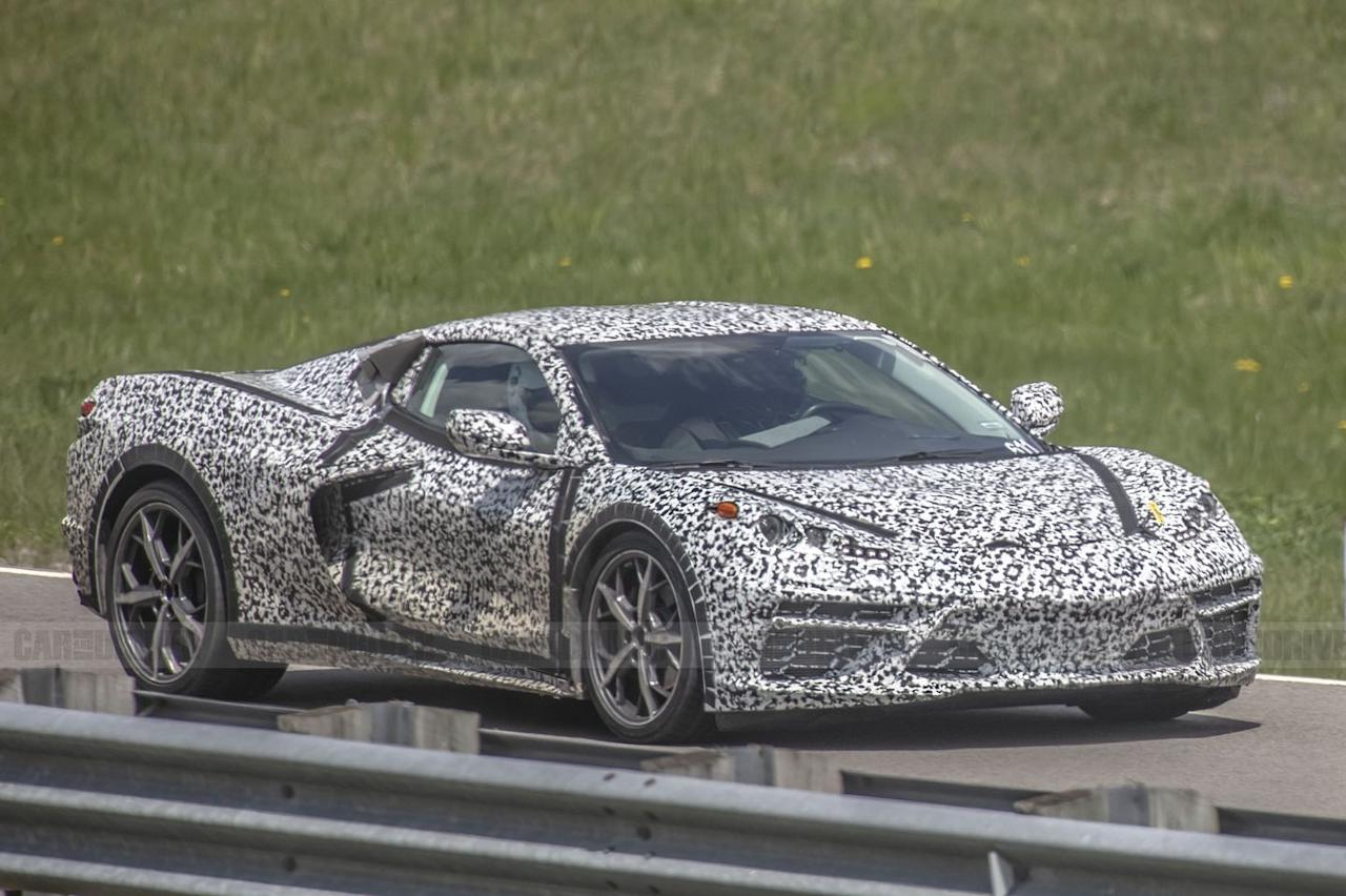 """<p>The black velcro strips you see on the doors and hood were <a href=""""https://www.caranddriver.com/photos/g20722222/fresh-mid-engine-corvette-spy-shots-reveal-new-details-gallery/?slide=22"""" target=""""_blank"""">previously used to affix extra camouflage</a> to obscure the Corvette's shape. Now that the car is officially confirmed, it seems the company has decided to let these prototypes breathe a bit more.</p>"""