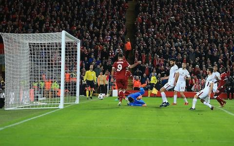Firmino is given his first goal on a gilded plate by Salah - Credit: Marc Atkins/Offside/Getty Images