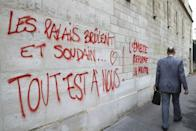 """Graffiti in Paris painted during a demonstration against labour reforms on June 14, 2016 that reads, """"the palaces burn and suddenly...all is ours!"""" (AFP Photo/Jacques Demarthon)"""
