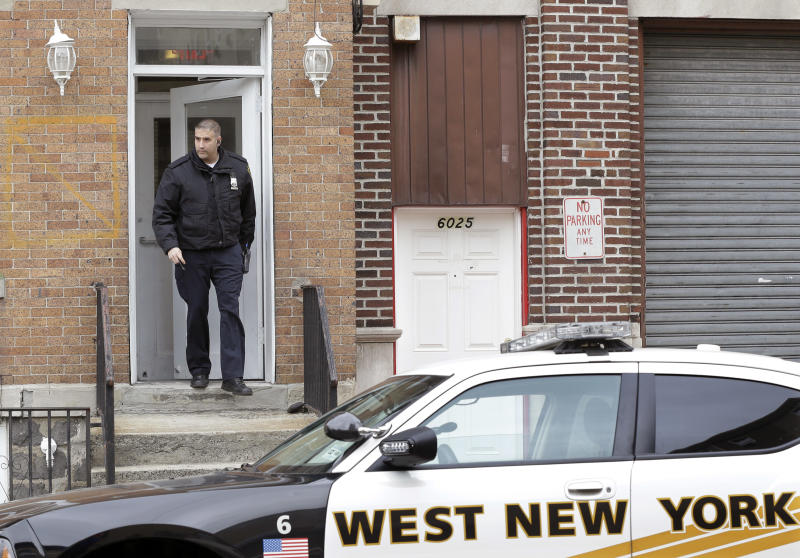 A West New York police officer walks back to his patrol car Tuesday, April 23, 2013, in West New York, N.J., from the apartment building where Ailina Tsarnaev lives. Tsarnaev, 22, a sister of the Boston Marathon bombing suspects plans to release a statement sometime Tuesday, according to attorney Joseph Ginarte, who said he represents the family. (AP Photo/Mel Evans)
