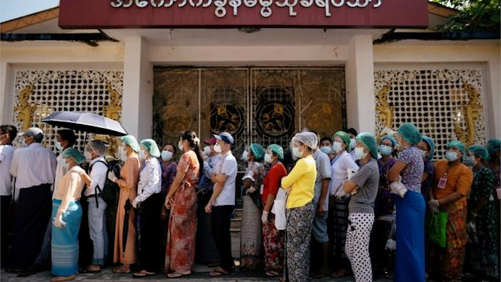 Voters queue up to cast their ballots in Yangon, Myanmar