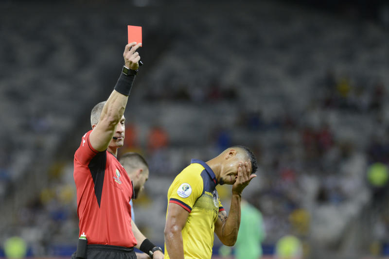Anderson Daronco, of Brazil, shows the red card to Ecuador's Jose Quinteros during a Copa America Group C soccer match against Uruguay at the Mineirao stadium in Belo Horizonte, Brazil, Sunday, June 16, 2019. (AP Photo/Eugenio Savio)
