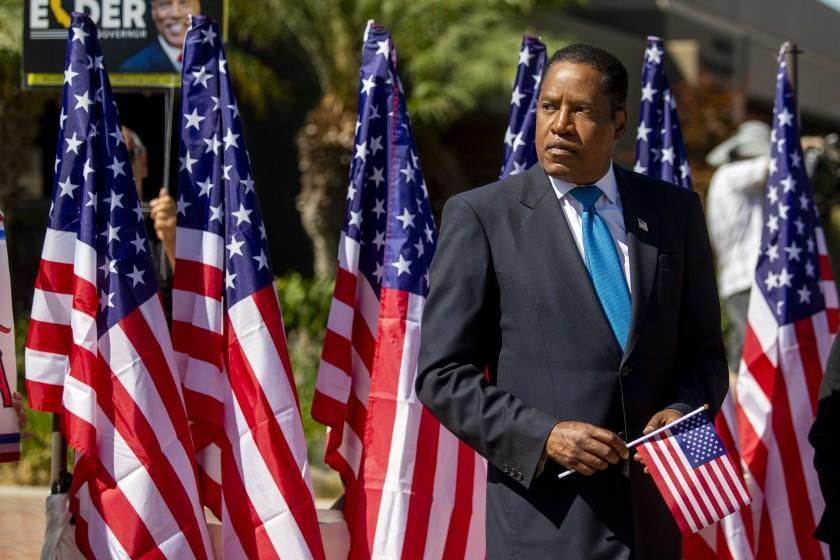 LOS ANGELES, CA - SEPTEMBER 13: Gubernatorial recall candidate Larry Elder will present a medal to a Chinese-American World War II veteran at the Monterey Park City Hall on Monday, Sept. 13, 2021 in Los Angeles, CA. Tomorrow is the election. (Francine Orr / Los Angeles Times)