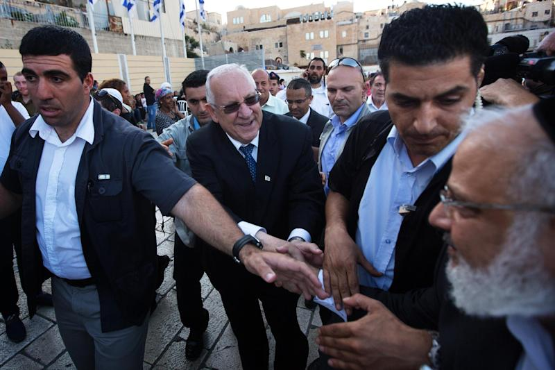 Israel's newly elected President and former minister and Knesset speaker Reuven Rivlin greets supporters as he arrive to visit at the Western Wall in the Jerusalem's Old City on June 10, 2014 (AFP Photo/Menahem Kahana)