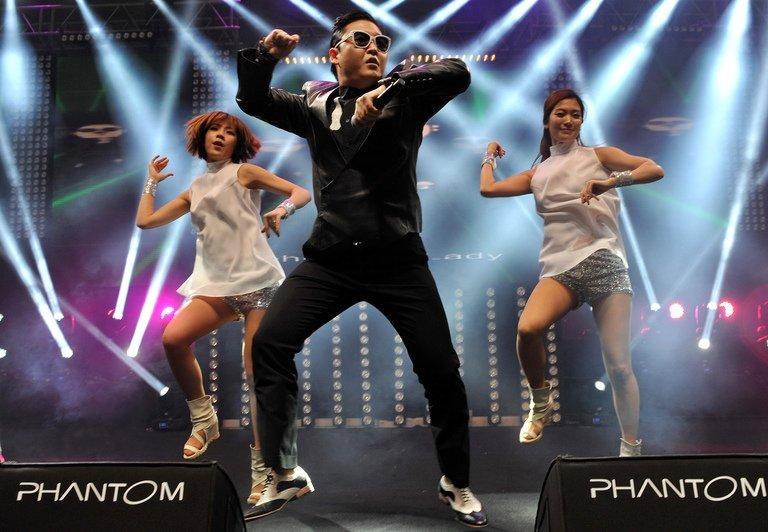 "South Korean singer Psy (L) performs his hit single ""Gangnam Style"" during a concert in Istanbul on February 22, 2013"