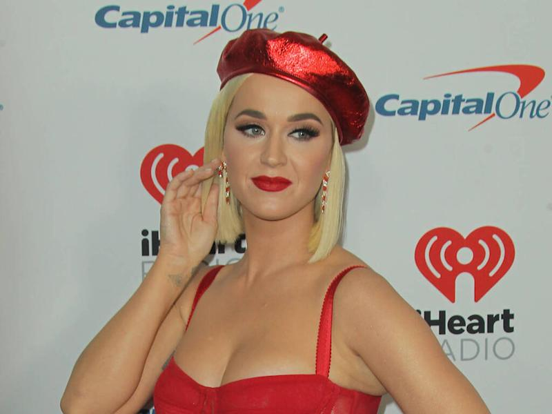 Katy Perry celebrates album release from hospital bed after giving birth to daughter Daisy