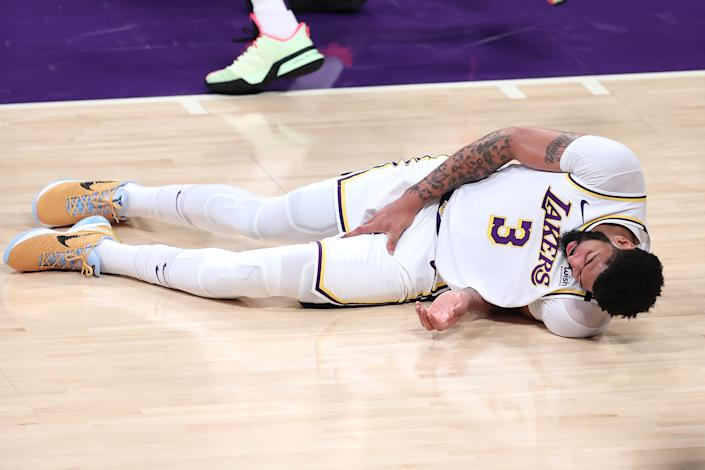 Anthony Davis grabs his thigh after falling during the first half of Game 4.