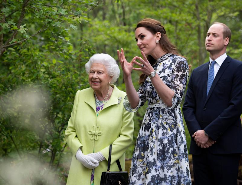 Kate shows the Queen around the 'Back to Nature' garden she co-designed at the Chelsea Flower Show [Photo: PA]