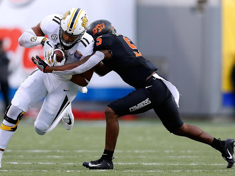 Kendall Blanton #11 of the Missouri Tigers is tackled by Kemah Siverand #5 of the Oklahoma State Cowboys during the first half of the AutoZone Liberty Bowl at Liberty Bowl Memorial Stadium on 31 December 2018 in Memphis, Tennessee: (Getty Images)