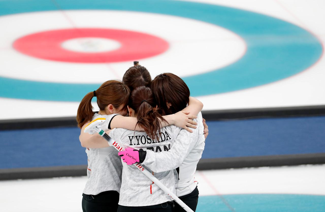 Curling - Pyeongchang 2018 Winter Olympics - Women's Bronze Medal Match - Britain v Japan - Gangneung Curling Center - Gangneung, South Korea - February 24, 2018 -Japanese curlers react after winning the match. REUTERS/Cathal McNaughton     TPX IMAGES OF THE DAY