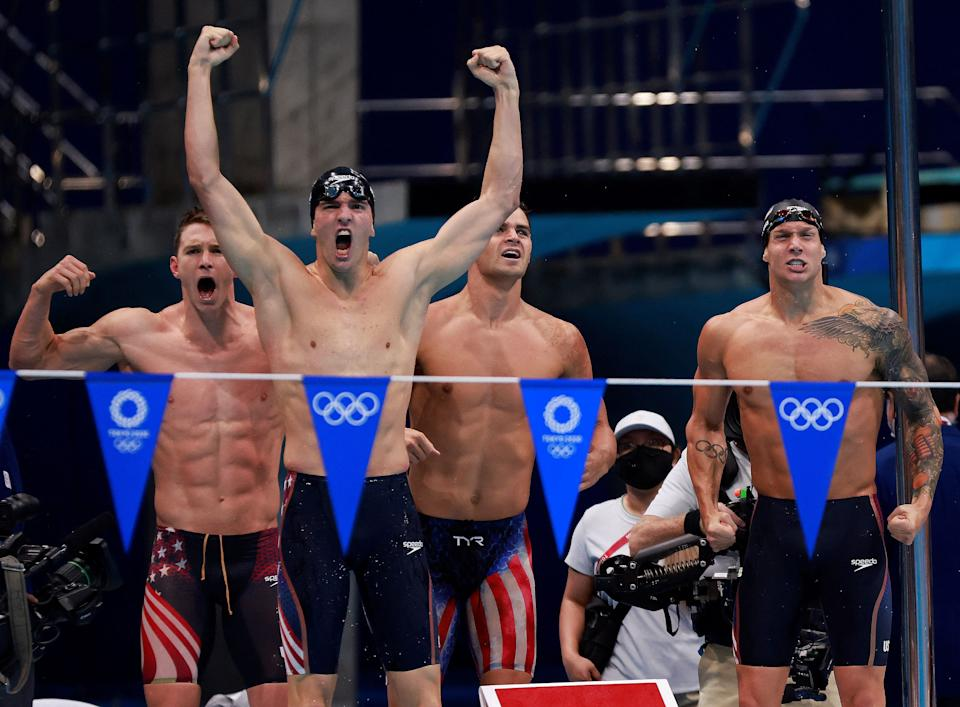 (From L) USA's Ryan Murphy, USA's Zach Apple, USA's Michael Andrew and USA's Caeleb Dressel celebrate winning to take gold in the final of the men's 4x100m medley relay swimming event during the Tokyo 2020 Olympic Games at the Tokyo Aquatics Centre in Tokyo on August 1, 2021. (Photo by Odd ANDERSEN / AFP) (Photo by ODD ANDERSEN/AFP via Getty Images)