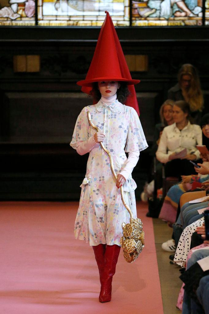 <p>Ryan Lo's SS19 show was a whimsical affair. So much so, that he even sent a knight in shining armour down the runway. Guests felt as though they'd stepped into the pages of a fairytale with models shielded by cone-shaped witch hats – broomstick-inspired accessories within their grasp. <em>[Photo: Getty]</em> </p>