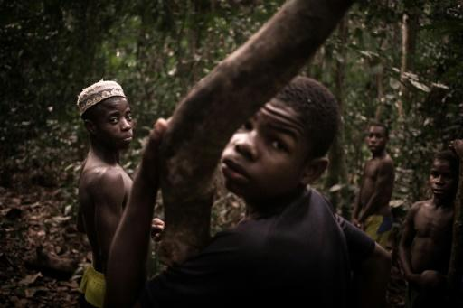 Young Bayaka Pygmies set up camp in the Dzanga-Sangha reserve in March