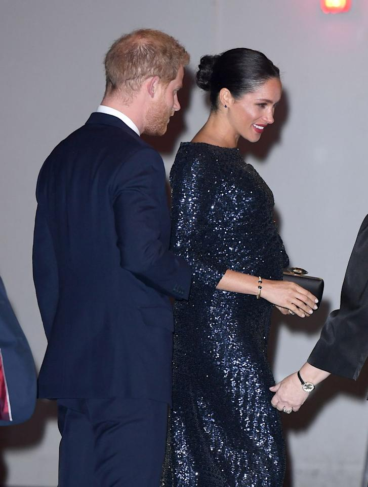 """<p>Worn twice by the former <em>Suits</em> star, this gold bracelet, featuring deep blue stones, previously belonged to the Duke of Sussex's mother, Lady Diana. </p><p>Markle has worn the chic bracelet twice - one during her Royal Tour of Australia, New Zealand, Fiji And Tonga, and once at the Royal Albert Hall to see the <a href=""""https://www.elle.com/uk/life-and-culture/a25932084/prince-harry-meghan-markle-hold-hands/"""" target=""""_blank"""">Cirque du Soleil premiere of TOTEM</a><em>.</em> </p><p>Buy a gold cuff like Meghan's <a href=""""https://www.net-a-porter.com/gb/en/product/1117778/Jennifer_Fisher/chain-link-gold-plated-cuff"""" target=""""_blank"""">here</a>.<em></em></p>"""