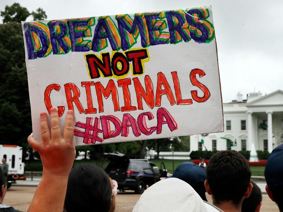 Demonstrators protest the Trump administration's decision to repeal DACA.