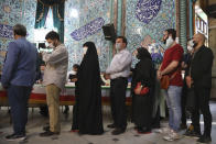Voters queue at a polling station during the presidential elections in Tehran, Iran, Friday, June 18, 2021. Iranians voted Friday in a presidential election dominated by a hard-line protege of Supreme Leader Ayatollah Ali Khamenei after authorities disqualified nearly all of his strongest competition, leading to what appeared to be a low turnout fueled by apathy and calls for a boycott. (AP Photo/Vahid Salemi)