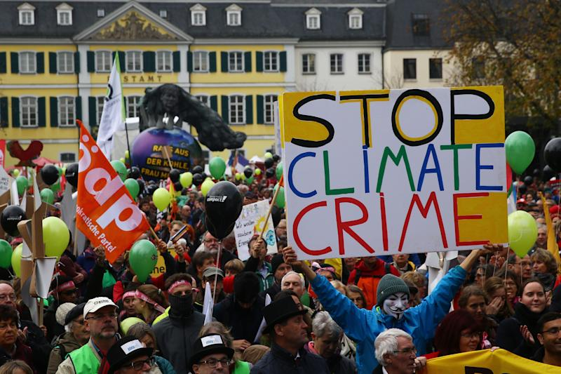 People march during a demonstration two days before the start of the COP 23 UN Climate Change Conference in Bonn, Germany, Nov. 4, 2017.