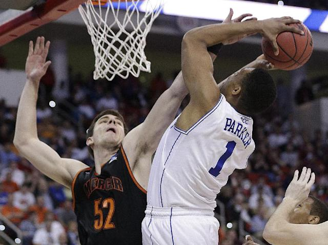 Duke forward Jabari Parker (1) shoots over Mercer forward Daniel Coursey (52) during the second half of an NCAA college basketball second-round game, Friday, March 21, 2014, in Raleigh, N.C. (AP Photo/Chuck Burton)