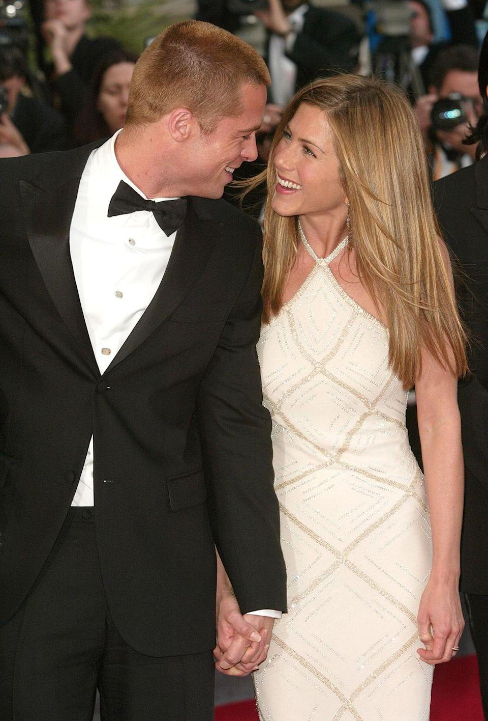 "<p>Golden couple Brad Pitt and Jennifer Aniston married in Malibu on July 29th, 2000. The now-divorced couple <a href=""http://www.people.com/people/archive/article/0,,20132034,00.html"" rel=""nofollow noopener"" target=""_blank"" data-ylk=""slk:reportedly recited quirky vows"" class=""link rapid-noclick-resp"">reportedly recited quirky vows</a>, that included Brad pledging to ""split the difference on the thermostat"" and Jennifer promising to always make his ""favorite banana milk shake.""</p>"
