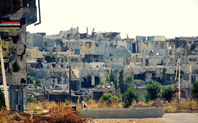 In this citizen journalism image provided by Lens Young Homsi, which has been authenticated based on its contents and other AP reporting, a general view of destroyed houses which was damaged by Syrian government forces shelling, at Baba Amr neighborhood, in Homs province, Syria, Thursday Oct. 18, 2012. Syrian activists say a string of government airstrikes on rebel areas in the country's north has killed at least 20 people, leveled buildings and forced residents to dig through mounds of rubble in search of survivors. (AP Photo/Lens Yong Homsi)