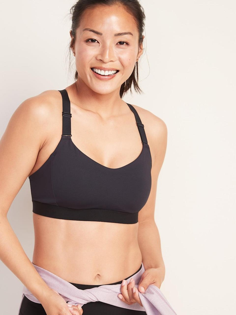 "<p>If you need more support, this <a href=""https://www.popsugar.com/buy/Old-Navy-Medium-Support-Powersoft-Adjustable-Strap-Sports-Bra-546334?p_name=Old%20Navy%20Medium%20Support%20Powersoft%20Adjustable-Strap%20Sports%20Bra&retailer=oldnavy.gap.com&pid=546334&price=25&evar1=fit%3Aus&evar9=47178917&evar98=https%3A%2F%2Fwww.popsugar.com%2Ffitness%2Fphoto-gallery%2F47178917%2Fimage%2F47179016%2FOld-Navy-Medium-Support-Powersoft-Adjustable-Strap-Sports-Bra&list1=shopping%2Cold%20navy%2Cworkout%20clothes&prop13=api&pdata=1"" class=""link rapid-noclick-resp"" rel=""nofollow noopener"" target=""_blank"" data-ylk=""slk:Old Navy Medium Support Powersoft Adjustable-Strap Sports Bra"">Old Navy Medium Support Powersoft Adjustable-Strap Sports Bra</a> ($25, originally $30) is for you.</p>"