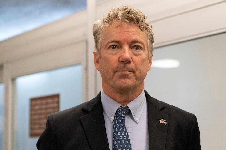 Sen. Rand Paul, R-Ky., listens to a reporter after speaking on the Senate floor, Tuesday, Jan. 26, 2021, in Washington. (AP Photo/Jacquelyn Martin)