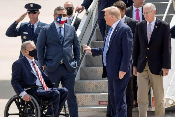 PHOTO: Chatting with Texas Gov. Greg Abbott, left, President Donald Trump stands with Rep. Mike Conaway, right, after their arrival in Midland, Texas, on Wednesday, July 29, 2020. (Ben Powell/AP)