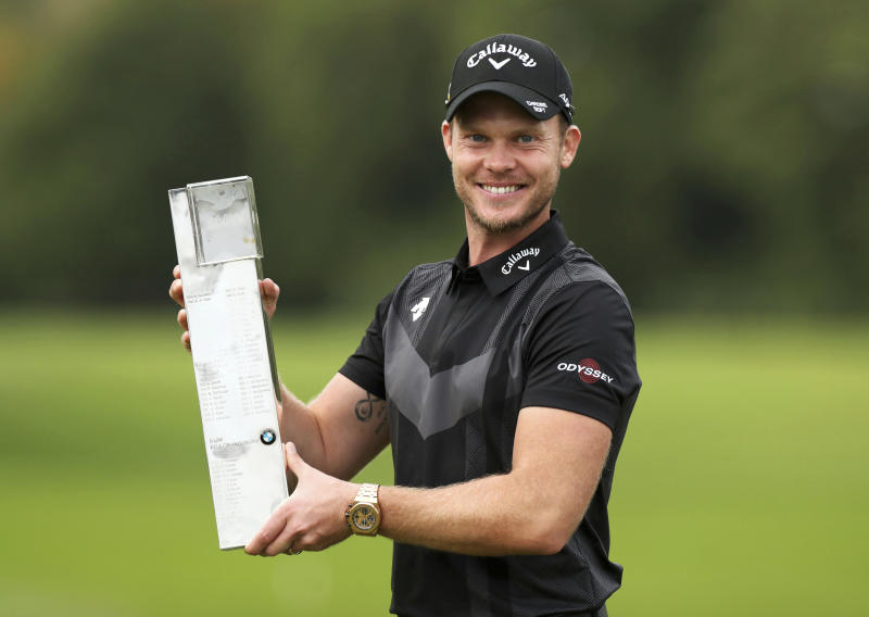 England's Danny Willett poses with the trophy after winning the PGA Championship at Wentworth Golf Club, Wentworth, England, Sunday Sept. 22, 2019. (Bradley Collyer/PA via AP)