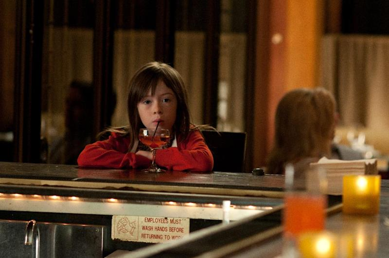 """This film image released by Millennium Entertainment shows Onata Aprile in a scene from """"What Maisie Knew."""" (AP Photo/Millennium Entertainment, Nicole Rivelli)"""